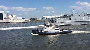 Austal USNS Yuma passes Tug