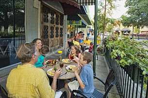 Downtown Activity - Families Dining Outside on Dauphin Street