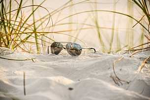 Sunglasses in the sand at the beach