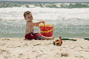 Beach Boy Playing